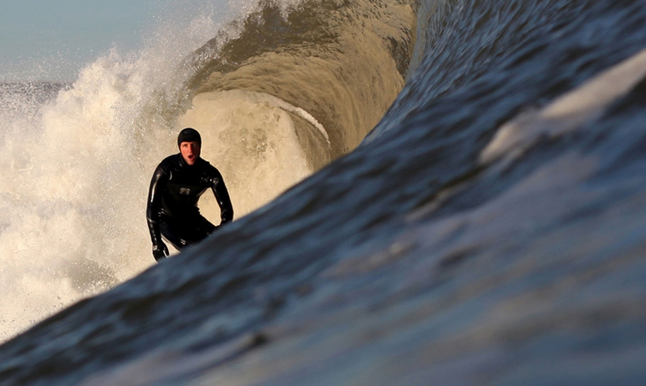 Northcore surfer riding wave